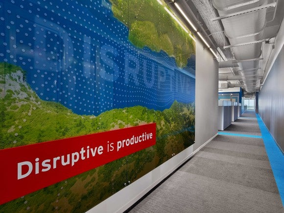 """Disruptive is productive"" slogan on a wall at Red Hat's headquarters."
