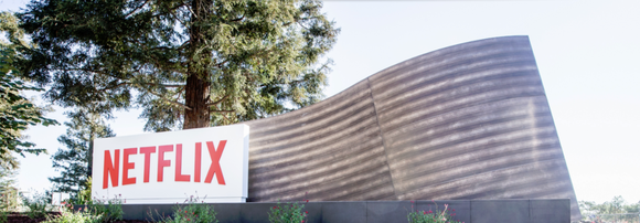 The Netflix logo on a stylized entryway sign.