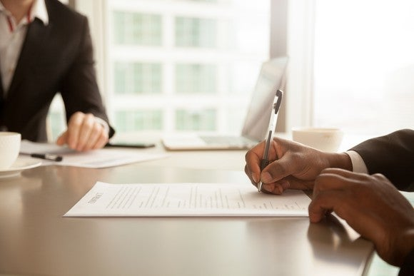 Signing new job paperwork