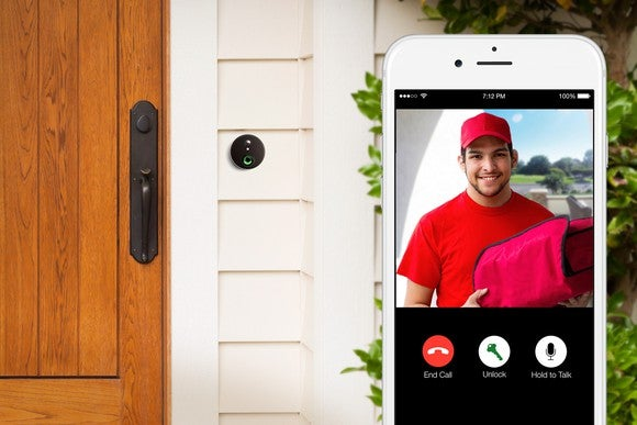 A person views who is at his door using a smartphone.
