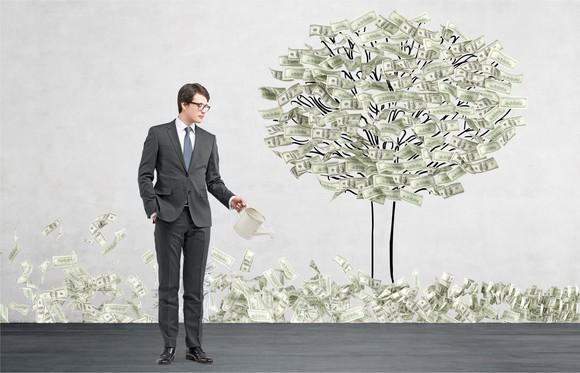 "A man ""growing"" a money tree."
