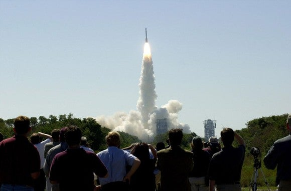 Spectators watch a Delta IV launch.
