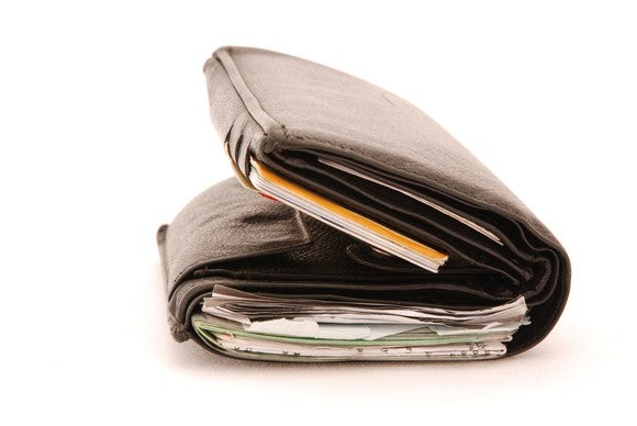 Thick wallet packed with items.