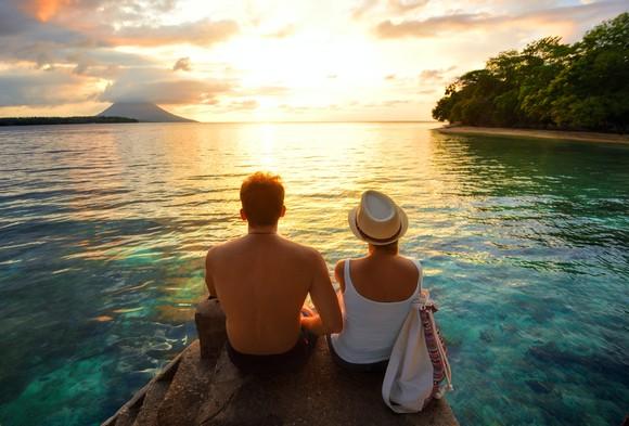 Couple watching an ocean sunset.