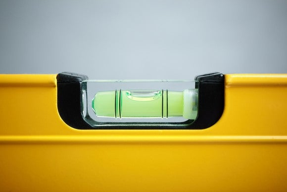 Close up of yellow carpenter's spirit level.