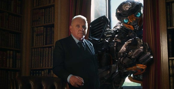 """Bumblebee and Sir Edmund Burton (played by Anthony Hopkins) from """"Transformers: The Last Knight."""""""