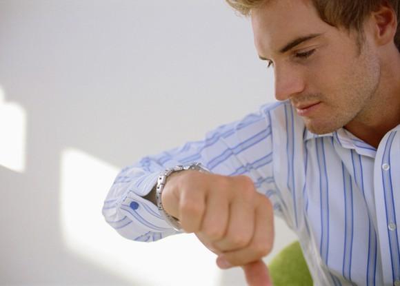 Man looking at his watch.