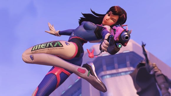 "Screenshot of ""Overwatch"" female character posing in an acrobatic leap in the air while pointing weapon at camera"