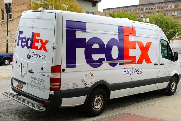 A FedEx Express delivery truck parked on the side of the road.
