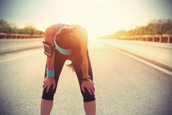 A runner rests after running.