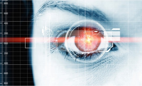 Woman's eye with technology images overlaid on it.