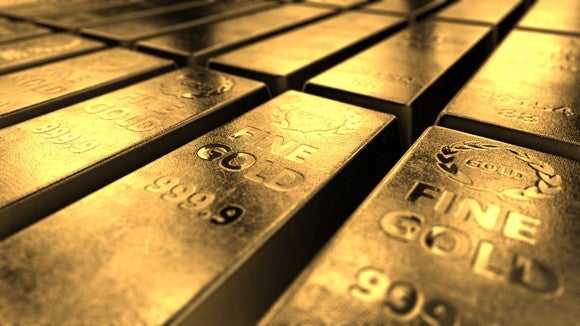 A row of stacked gold bars.