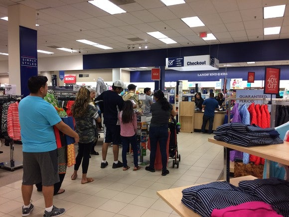 A long checkout line at Sears
