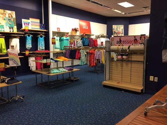 The accessories display in this Lands' End shop is nearly empty.