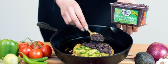 Someone cooking in a skillet with a product from The Better Bean Company
