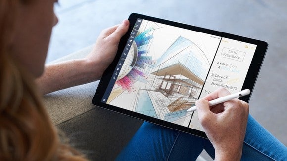 An artist sketching on the 12.9-inch iPad Pro.