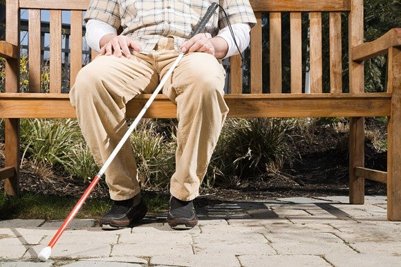 Blind man sitting on a bench