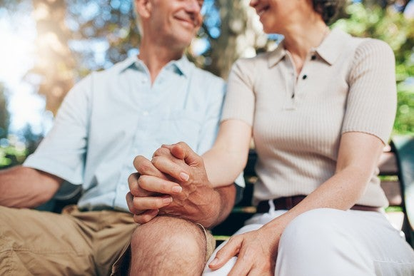 Senior couple holding hands