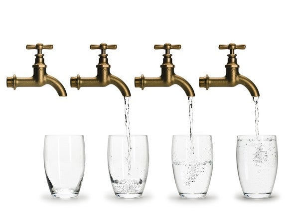 A row of faucets filling up glasses of water.