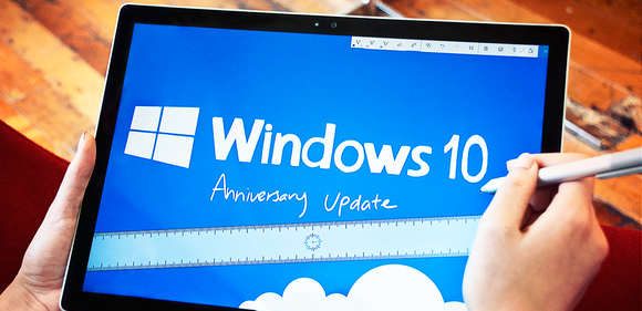 A tablet user interacting with Windows 10.