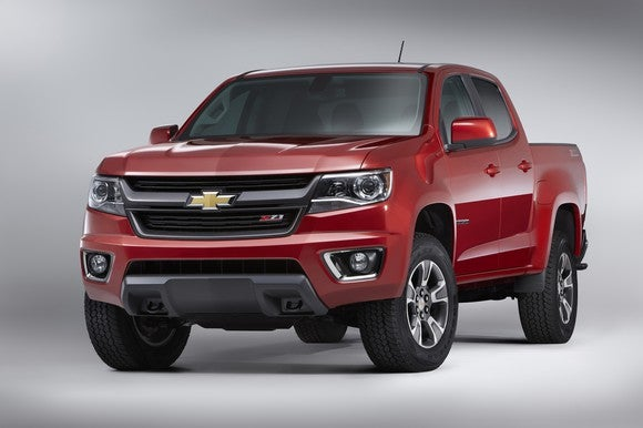 A red Chevy Colorado pickup