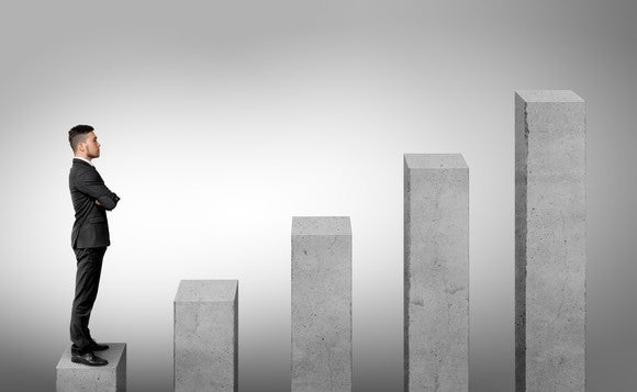 business man looking at growing columns