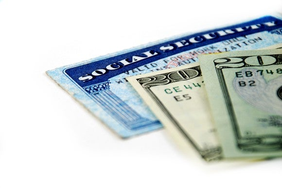 Social Security card with $20 bills on it.