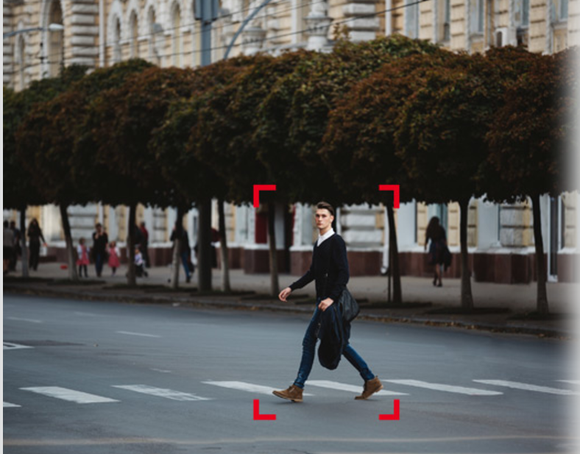 Demonstration of computer vision seeing a man crossing the street.