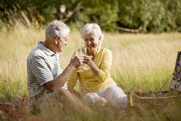 Senior couple toasting outdoors