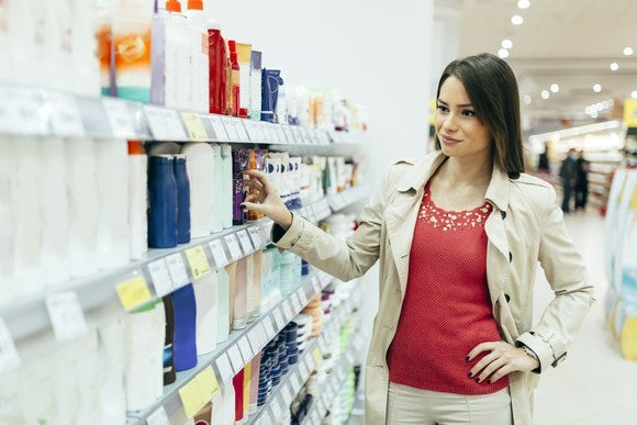 Woman shopping for personal care products.