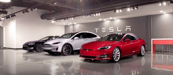 Model S and Model X vehicles in a showroom