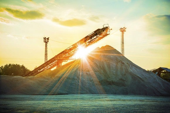 The sun shining over a pile of sand.