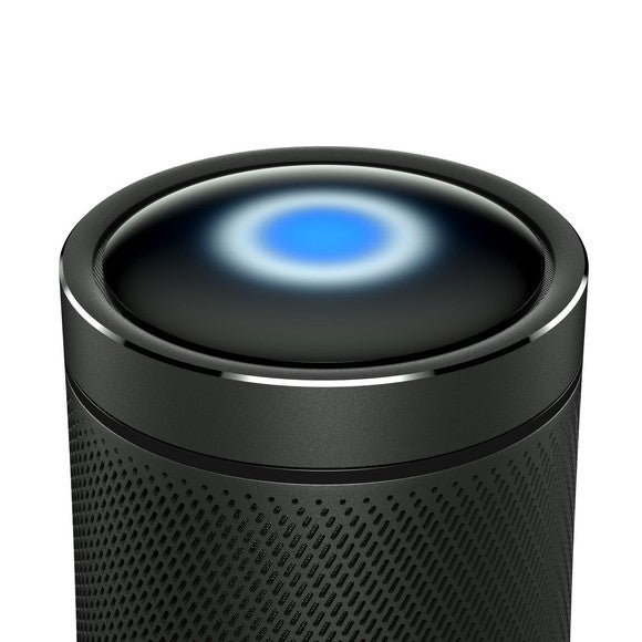 Black cylindrical speaker with glowing blue light in the top.