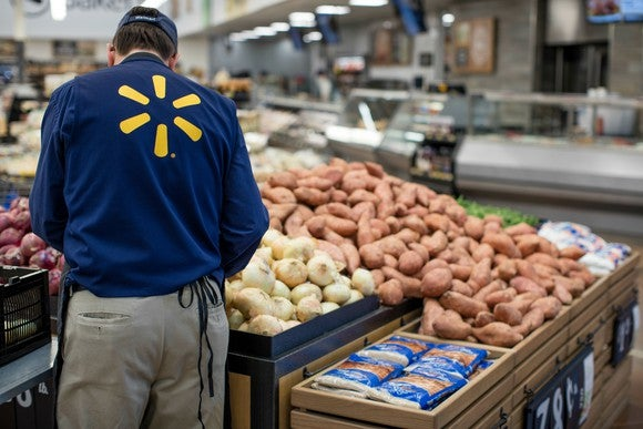 A Wal-Mart worker in the produce section