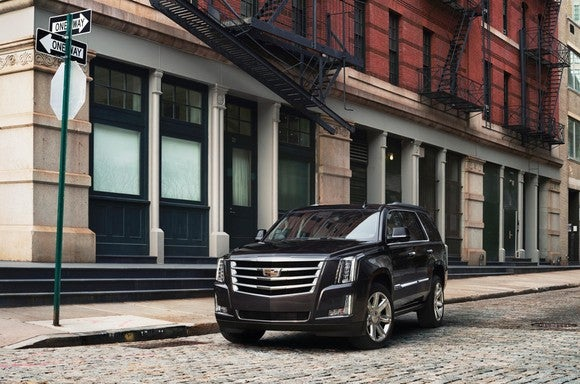 A 2017 Cadillac Escalade in black.