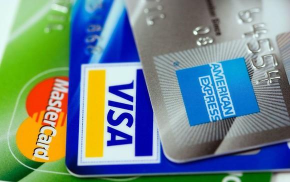 An American Express card, Visa card, and Mastercard card