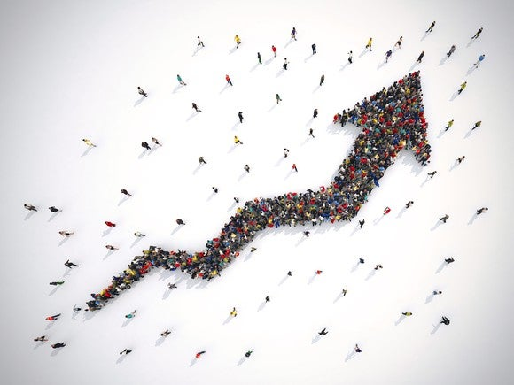 An overhead view of people forming an arrow.