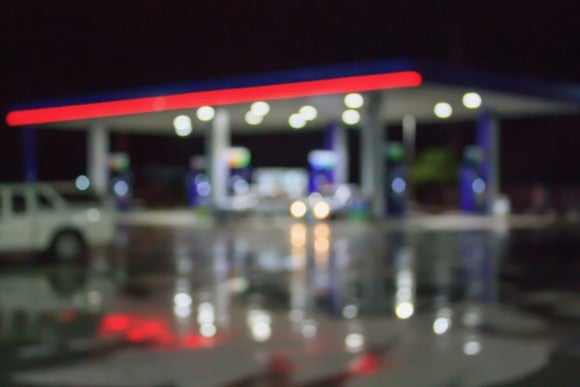 Blurred photo of a gas station.