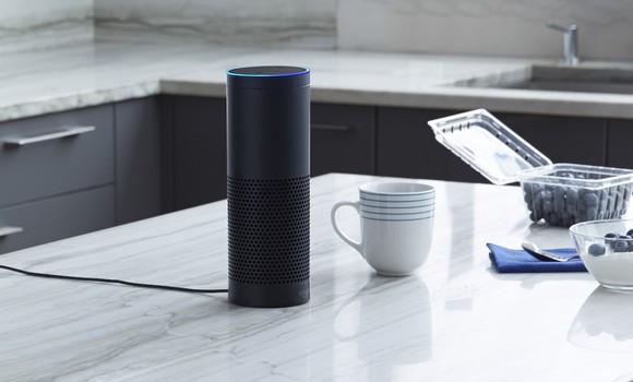 Amazon Echo sitting on kitchen countertop.