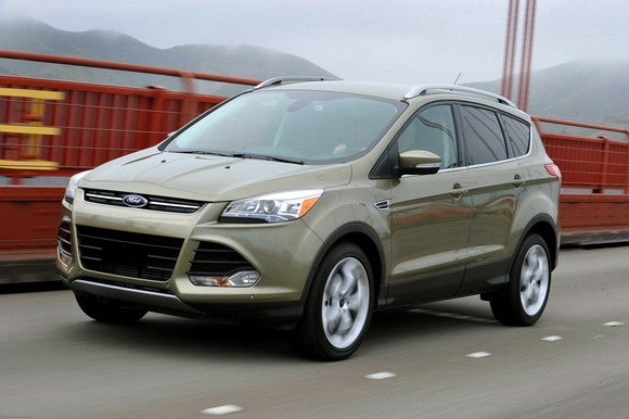2013 Ford Escape driving on a bridge.