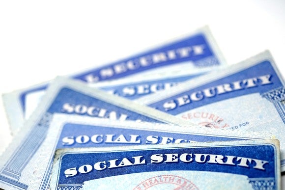 Social Security cards stacked atop each other.
