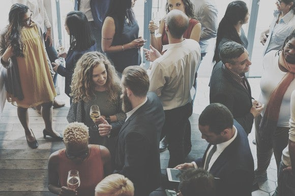 People mingle at a busines event