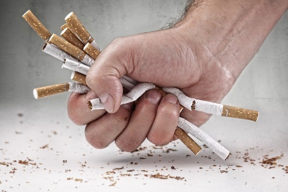 Hand crushing cigarettes