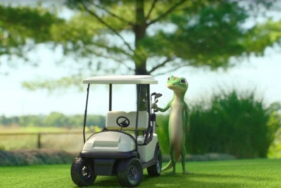 The GEICO gecko loading up a golf cart