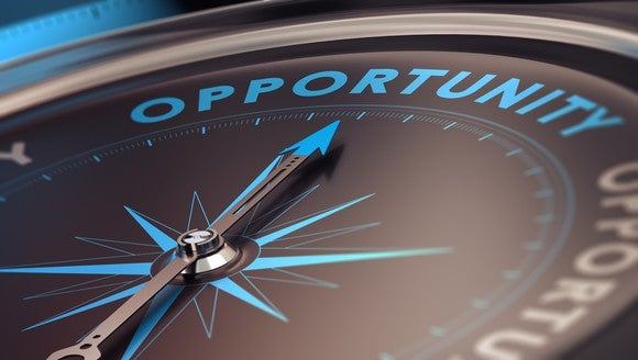 """Compass with needle pointing to the word """"opportunity."""""""