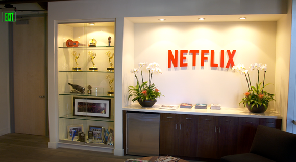 Netflix logo above a desk in an office.