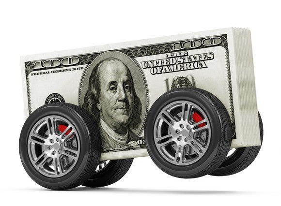 Stack of $100 bills with four wheels on it, like a car.
