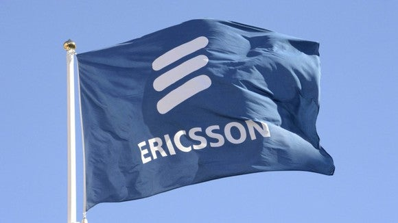 A flag flying in the wind sports the Ericsson logo.