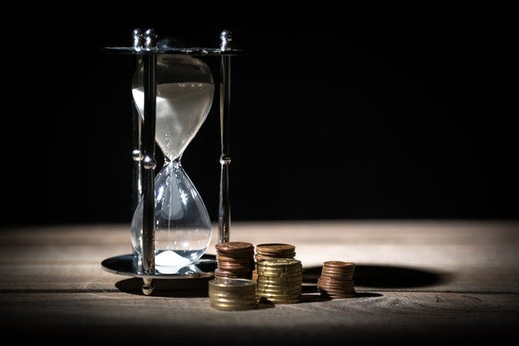 Hourglass and coins.