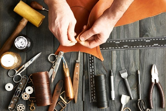 Craftsman working on a leather product